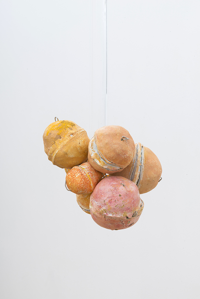 Untitled (Citrus Balls 2) Solid cast acrylic rod, various citrus fruit rinds, epoxy putty, oil pastel, stainless steel wire, and enamel; dimensions variable; 2018