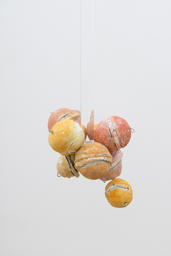 Untitled (Citrus Balls 5) Solid cast acrylic rod, various citrus fruit rinds, epoxy putty, oil pastel, stainless steel wire, and enamel; dimensions variable; 2018